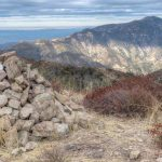 Cairn, with summit register, on Brown Mountain with Mt. Lukens in the background